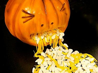 Display halloween pumpkin cake throwing up seeds