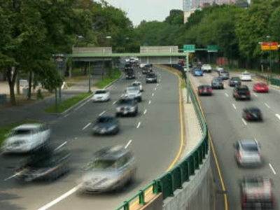 Display stock footage time lapse of traffic along storrow drive in boston on summer day